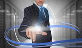 Uomo d'affari, toccare grafico interfaccia futuristica con vorticoso — Foto Stock