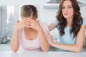 Woman comforting her overwhelmed friend — Stock Photo