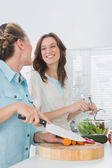 Pretty women preparing salad together — Stock Photo