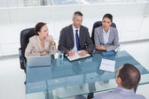 Concentrated business team interviewing experienced man — Stock Photo
