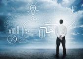 Empresario teniendo en cuenta una lluvia de ideas — Foto de Stock