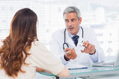 Doctor talking with his patient seriously — Stock Photo