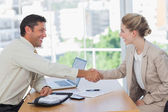 Blonde woman shaking hands while having an interview — Stock Photo