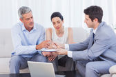 Salesman giving contract to client and his wife — Stock Photo