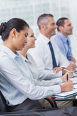 Cheerful employees attending presentation — Stock Photo