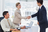 Business people shaking hands with their future patner — Stock Photo