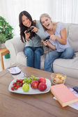 Happy friends playing video games and laughing — Stock Photo