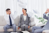 Businessmen shocked at colleague screaming and throwing papers — Stock Photo