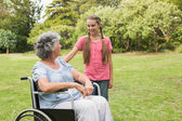Granddaughter with grandmother in her wheelchair — Foto Stock