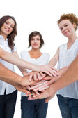 Peaceful women joining hands in a circle — Stock Photo