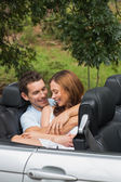 Cute couple cuddling in the backseat and chatting — Stock Photo