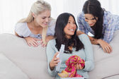 Woman looking thankful for present from her friends — Stock Photo