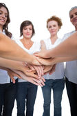 Relaxed models joining hands in a circle — Stock Photo