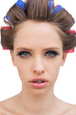 Model with hair curlers in close up — Stock Photo