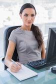 Confident businesswoman taking notes — Stock Photo