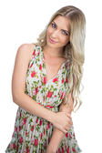 Relaxed seductive blonde wearing flowered dress posing — Stock Photo
