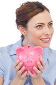 Businesswoman holding her piggy bank — Stock Photo
