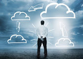Businessman considering cloud computing graphics — Zdjęcie stockowe