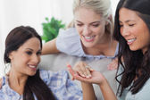 Friends admiring brunettes engagement ring — Stock Photo