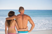 Loving couple embracing one another while looking at the sea — Foto de Stock