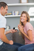Man on one knee proposing to happy girlfriend — Stock Photo