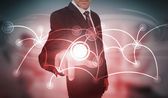 Businessman selecting futuristic circle with connecting lines in — Stock Photo