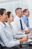 Cheerful workmates attending presentation — Stock Photo