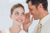 Employee telling secret to his colleague — Stock Photo