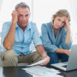 Anxious couple paying their bills online with laptop — Stock Photo