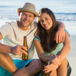 Smiling couple embracing while having a drink together — Stock Photo #29460261