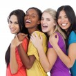 Diverse young women laughing at camera and embracing — Stock Photo #29460413