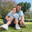 Happy father with child in a park — Stock Photo