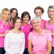 Beautiful women posing and wearing pink for breast cancer — Stock Photo