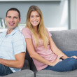 Relaxed couple sitting on the couch together — Stock Photo