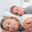 Peaceful couple sleeping and spooning in bed — Stock Photo
