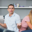 Couple sitting back to back after a fight on the couch with man — Stock Photo #29461131