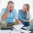 Worried couple using their laptop to pay their bills — Stock Photo #29461929