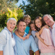 Stock Photo: Smiling family and grandparents in the countryside