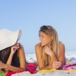 Two pretty women lying on the sand — Stock Photo