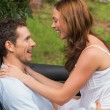 Stock Photo: Young couple feeling romantic in back seat and laughing