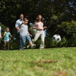 Cheerful multi generation family playing football  — Stock Photo