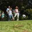 Stock Photo: Cheerful multi generation family playing football