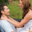 Happy couple feeling romantic in back seat and laughing — Stockfoto