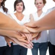 Stock Photo: Relaxed women joining hands in circle