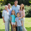 Smiling family and grandparents in the park — Stock Photo