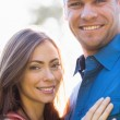 Happy couple standing outside — Stock Photo #29463819