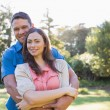 Embracing couple outside — Stock Photo #29463825