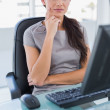 Pensive businesswoman sitting on her swivel chair — Stock Photo