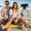 Cheerful couple posing while having barbecue — Stock fotografie