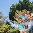 Nice family and grandparents pointing into the sky — Stock Photo